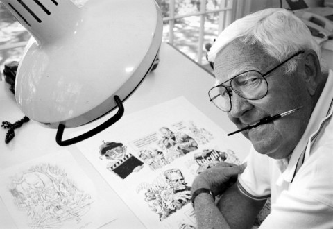 Jack Davis sits at his drawing board at his Georgia home in 1997.