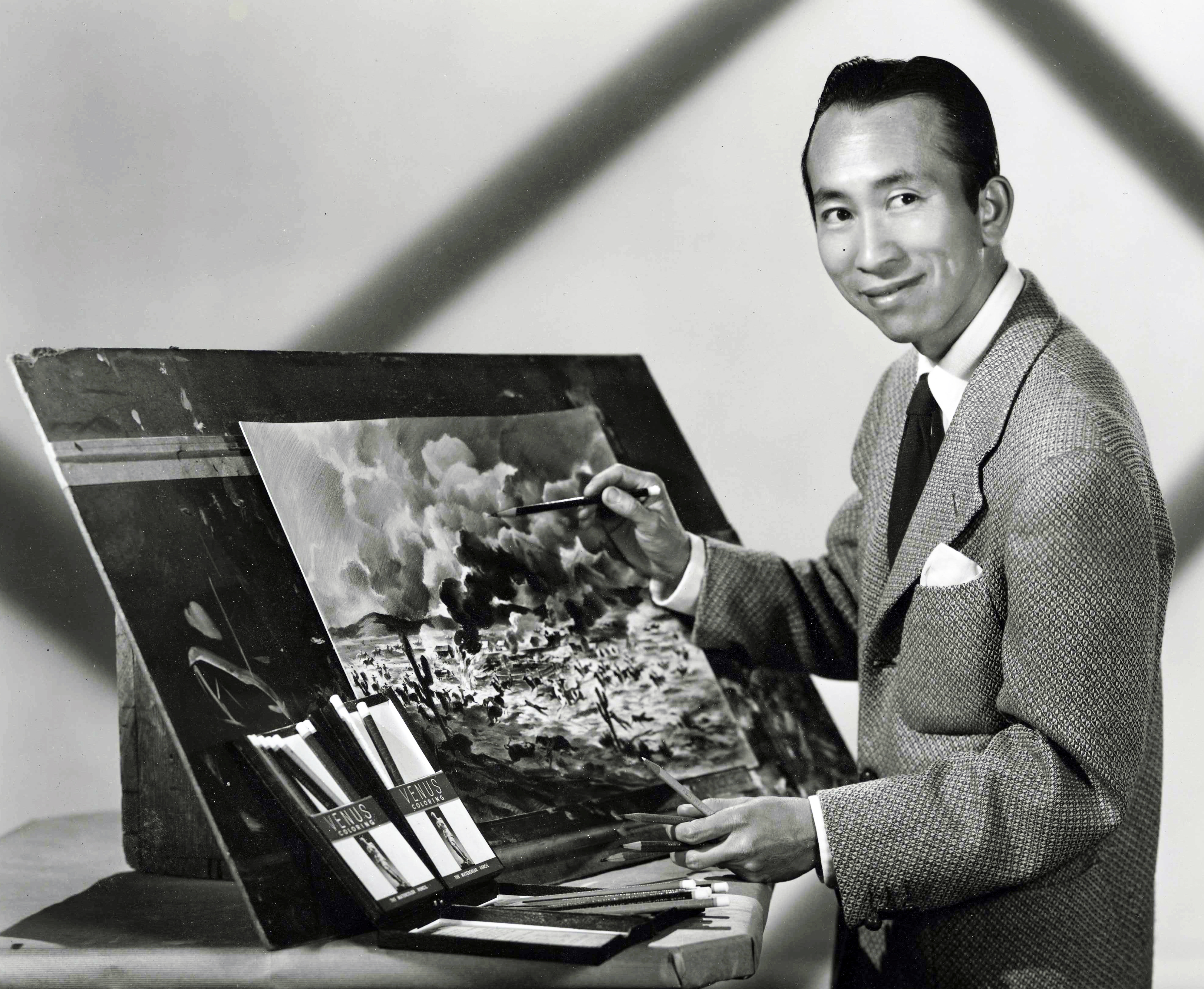 Tyrus Wong working on a Warner Bros western movie production Circa 1940s.