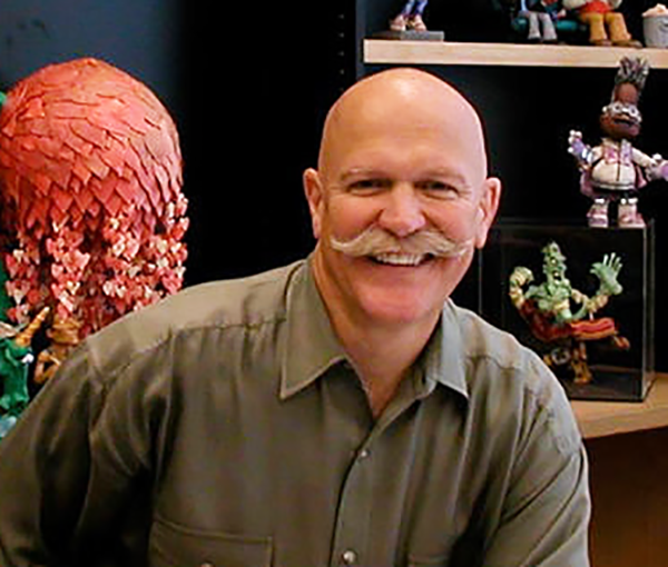 Will Vinton posing for photo in his office.